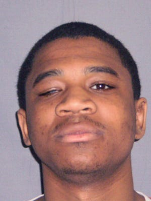 In an undated photo provided by the Michigan Department of Corrections, Davontae Sanford is shown in a booking photo. The Michigan Supreme Court says the young Detroit man can't withdraw his guilty plea to four murders that occurred when he was 14. Sanford has been trying to undo his guilty plea for more than five years.  Sanford is in prison for the deaths of four people in 2007. But weeks after Sanford's guilty plea, a hit man took responsibility for the Runyon Street homicides. (AP Photo/Michigan Department of Corrections)