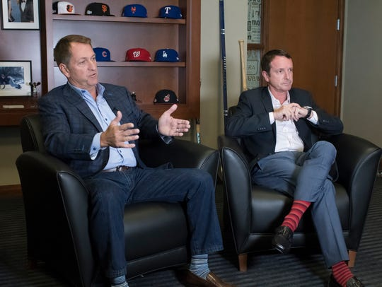 New Era Cap Company CEO Chris Koch (left) and Paul