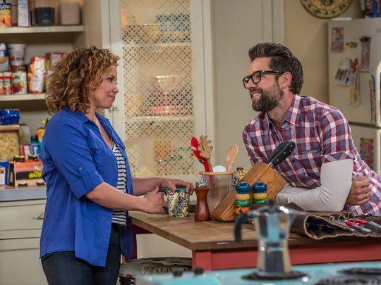 Justina Machado and Todd Grinnell in a scene from the