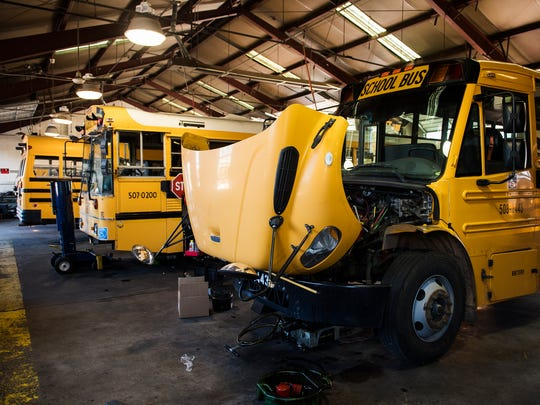 School buses are parked for maintenance at a Greenville