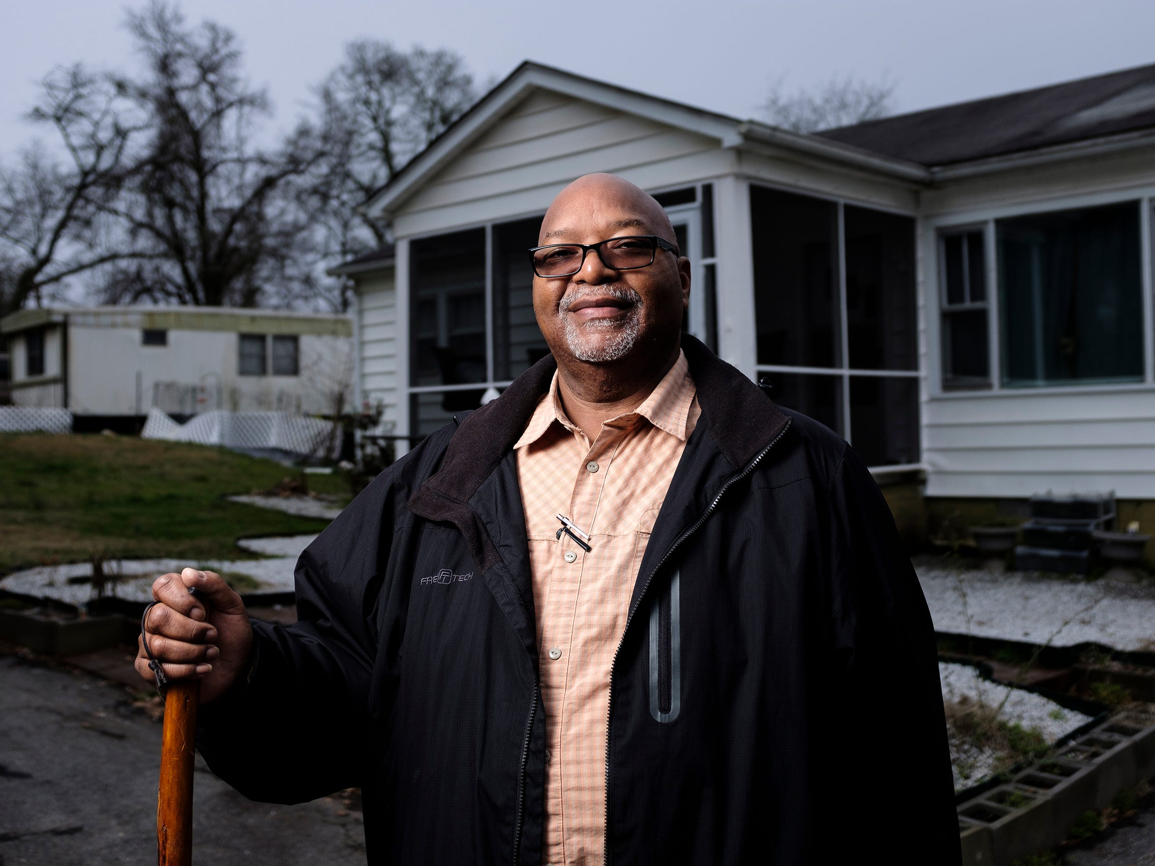 """Cory Massey, 66, moved into his current residence in the Calhoun neighborhood in 2000, but he says he grew up just down the street in a home his family moved into in the 1960s. Their home eventually burned down. """"The Comfort Inn is in our front yard now where our house used to be,"""" Massey says."""