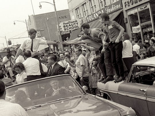 Sen. Robert Kennedy in an open convertible in a motorcade