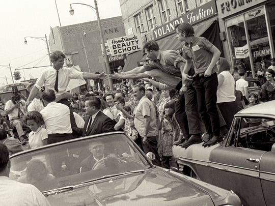 Sen. Robert Kennedy in an open convertible in a motorcade through Detroit during his his May 15, 1968 visit to Detroit, the last time he visited Michigan before his assassination that June.