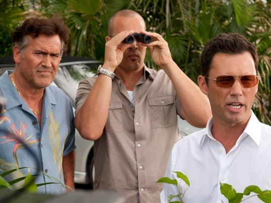 From left: Bruce Campbell, Coby Bell and Jeffrey Donovan on 'Burn Notice.'