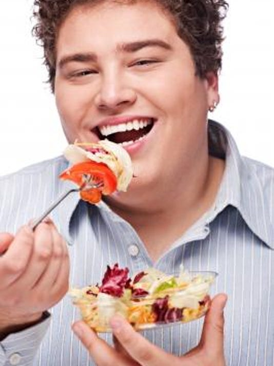 overweight male with salad