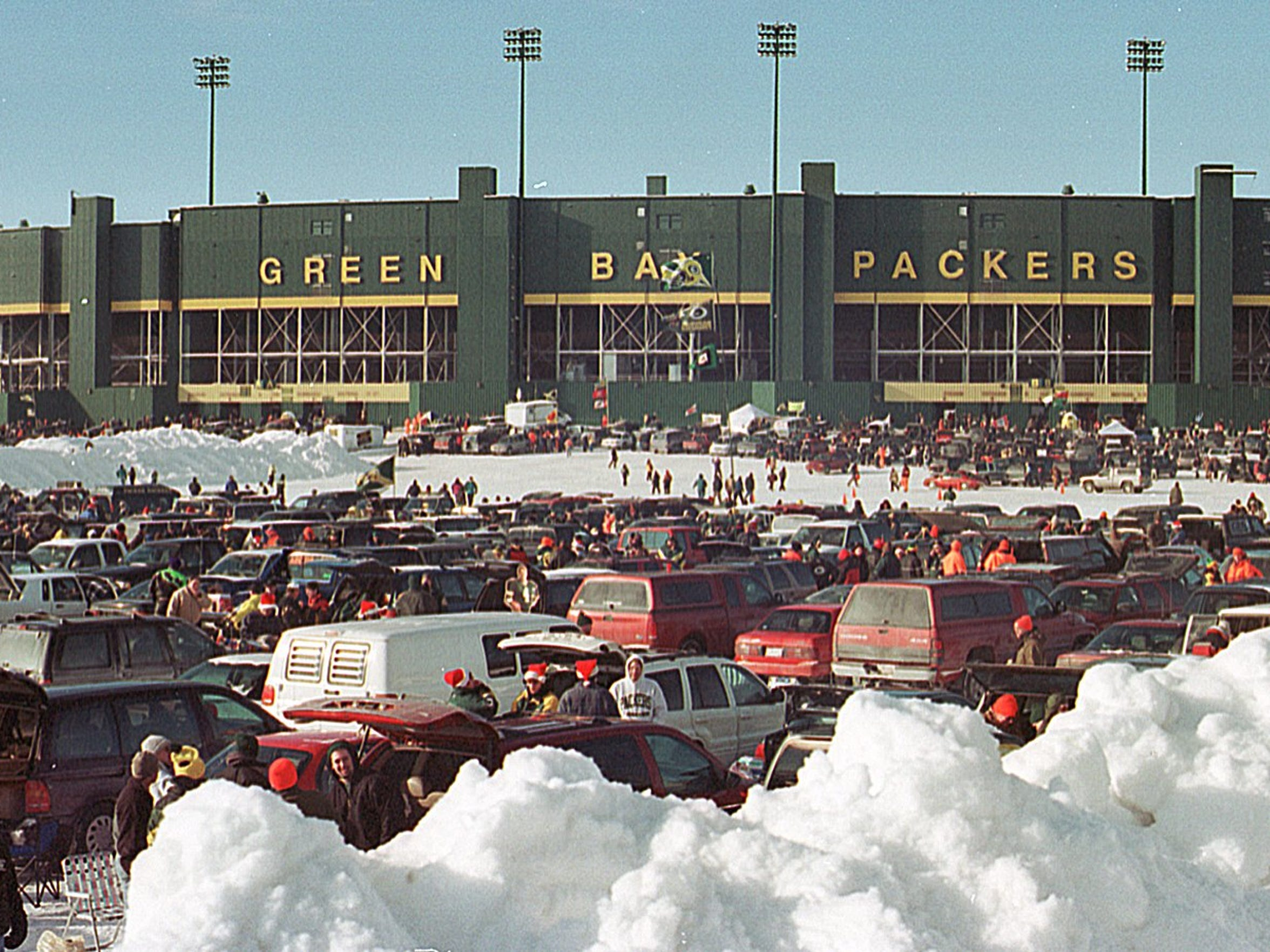 Tailgaters celebrate before the Packers take on the Tampa Bay Buccaneers on Dec. 24, 2000, the last game before Lambeau Field underwent a massive renovation.
