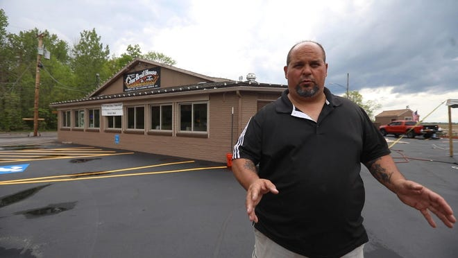 Dave Palumbo, owner of The Original Char Broil House, has a tent he purchased erected in the back parking lot Friday, May 29. Palumbo had filled out all the permits for the Town of Greece, and was waiting for the official go-ahead to have outdoor dining.