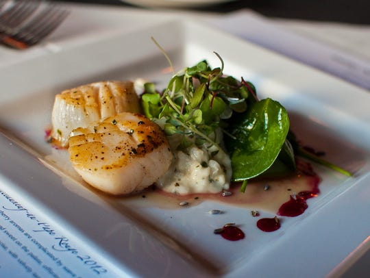 Lavender honey-glazed pan-seared scallops served with