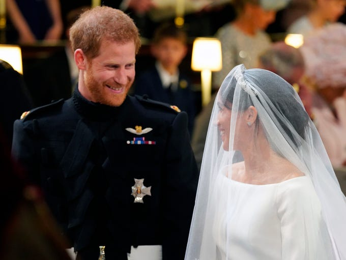 It's royal wedding day! Prince Harry couldn't stop
