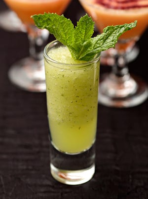 Soup Shooters Fruit soup shooter of Honeydew and mint with Moscato.