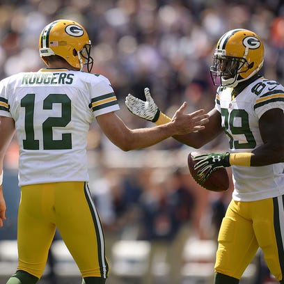 Packers quarterback Aaron Rodgers congratulates receiver