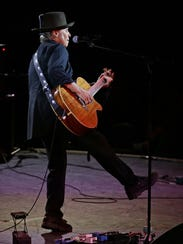 Scottsdale's Nils Lofgren performs after being inducted