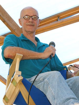 The late Dave Johnson photographed at his usual perch on the judge's stand high above duck race tracks. The stand has been named in his memory and he will posthumously serve at grand marshal of the Tournament of Ducks Parade on Aug. 27.