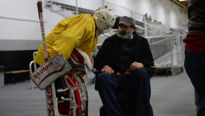 """Former Plymouth-Canton Community Schools teacher Steve Roth talks with """"Father D"""" between games at the Plymouth Cultural Center."""