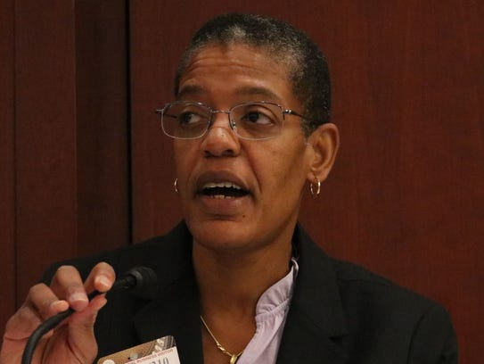Dr. Michelle Williams speaks at a meeting on domestic
