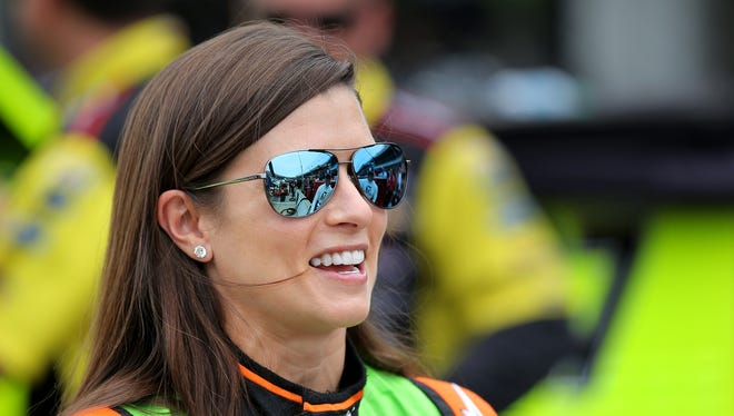 NASCAR driver Danica Patrick shares a laugh with fellow driver Jamie McMurray before qualifying at the Indianapolis Motor Speedway on July 26, 2014.