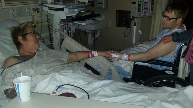 Taylor Erickson (right) and his mother recover after surgery in which he donated a kidney to her.