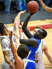St. Cloud Apollo's Deng Diew takes a shot against Big