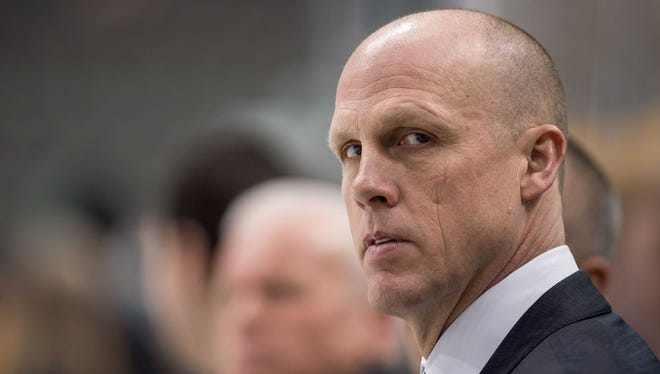Boston Bruins assistant coach Doug Houda watches his team skate prior to a game against the Dallas Stars on Jan. 20, 2015.