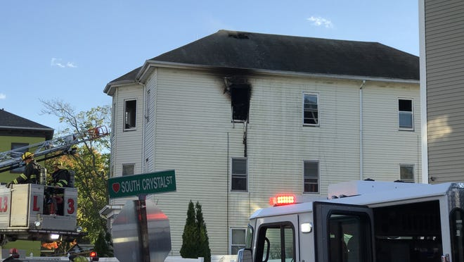 A three-decker at 3 South Crystal St. shows damage from a fire Wednesday afternoon.