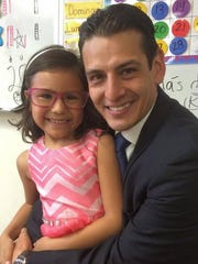 Marcelino Quiñonez and his daughter, Mia, pose at a school event in 2015.