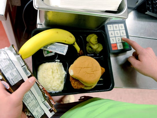 A student pays for his school lunch in the Erwin Middle