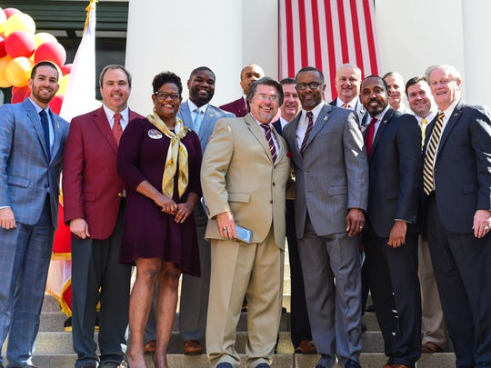 Florida State President John Thrasher and head football coach Willie Taggart pose with Florida lawmakers during the annual FSU at the Capitol Day on Tuesday, February 6th.