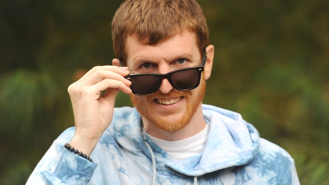Josh Fitzmaurice, owner of SLYK Shades, says the mission of his wooden sunglasses business is to spread positivity, kindness and compassion and to support nonprofit groups such as One Tree Planted, which plants a tree for every pair of sunglasses sold.