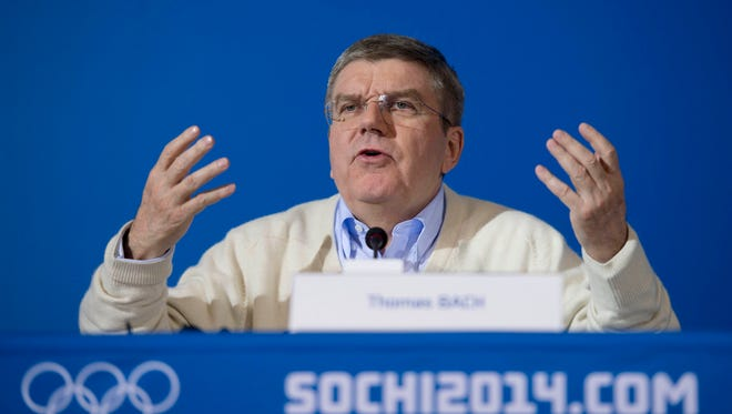 IOC President Thomas Bach will attend his first football game Sunday at Super Bowl XLIX and met with NFL Commissioner Roger Goodell.