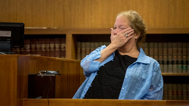 Roxanne Polidan-Jackson cries and wipes a tear as she recalls finding her deceased daughter in her basement during a preliminary examination Friday, September 23, 2016 in the courtroom of Judge Cynthia Plazter at the St. Clair County Courthouse in Port Huron. Douglas Ball Jr. is charged with open murder and torture in the August death of his wife, Lydia Ball.