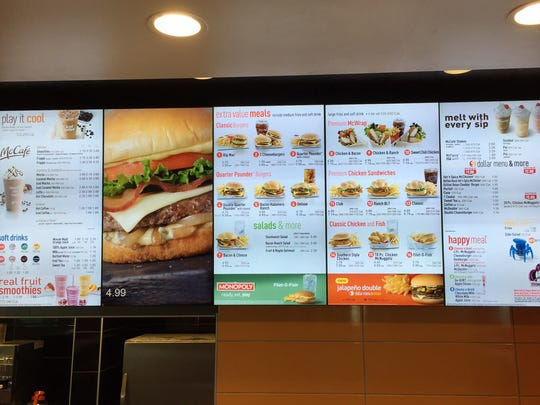 Digital menu boards are part of the modernization taking place at fast-food restaurants that are becoming more sleek and more technologically advanced.