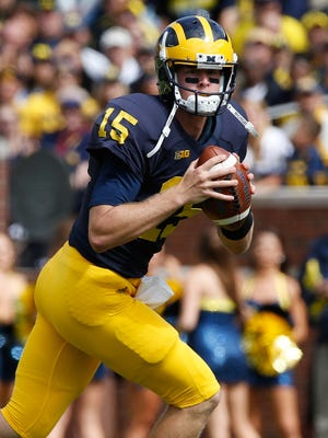 Jake Rudock of the Michigan Wolverines looks for an open receiver during the first quarter against UNLV on Sept. 19, 2015, at Michigan Stadium in Ann Arbor.
