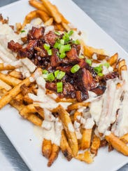 Sliced de-boned spare ribs served over cheesy fries