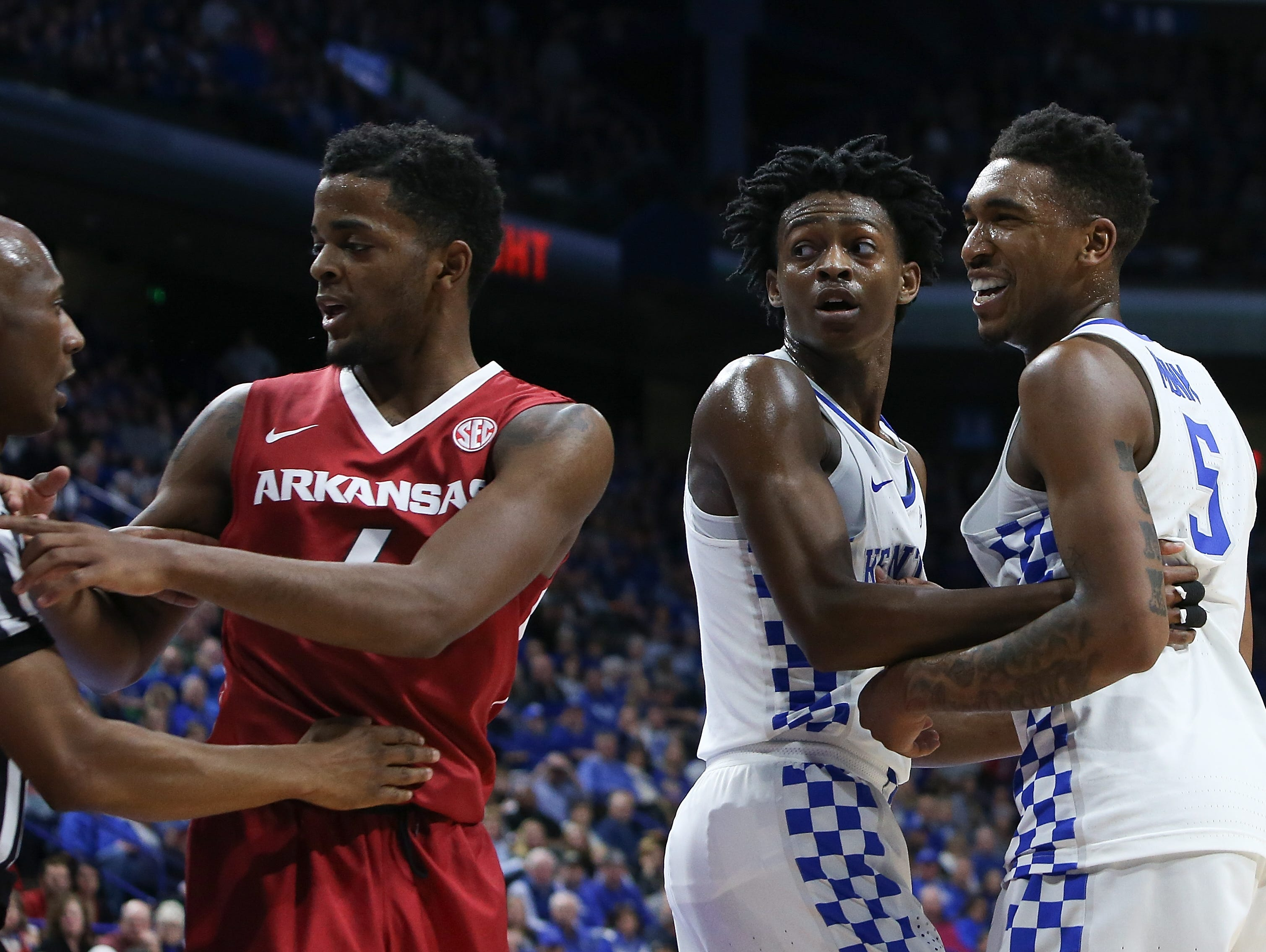Referee Alfred Smith breaks up an argument between Arkansas Razorbacks guard Daryl Macon and Kentucky Wildcats guard Malik Monk during the second half at Rupp Arena in Lexington, Kentucky on Saturday, January 7, 2017.