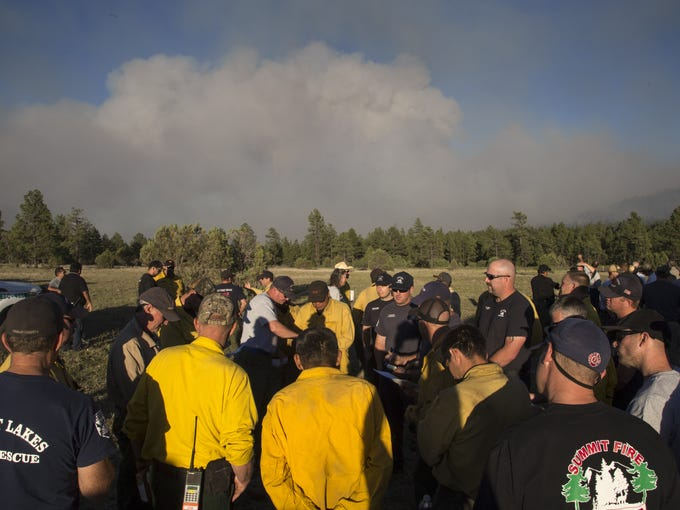 Firefighters are briefed for night operations, June
