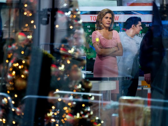 """Anchor Hoda Kotb stands on the set of the """"Today"""" show between segments Wednesday, Nov. 29, 2017, in New York, after NBC News fired host Matt Lauer. NBC News announced Wednesday, Nov. 29, 2017, that Lauer was fired for """"inappropriate sexual behavior."""""""