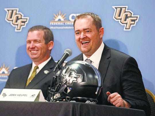 Josh Heupel has big shoes to fill as UCF's head coach. He replaces Scott Frost, who led the Knights to an undefeated season before leaving to take the head coaching job at Nebraska.