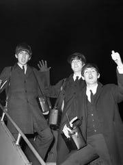 George Harrison, John Lennon and Paul McCartney, pictured