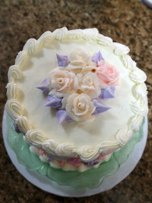 Decorating with buttercream, featured on this fake cake, is another class being offered by Cherry City Cake & Candy Supply.