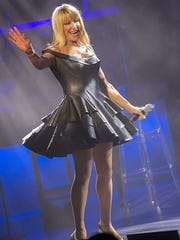 Suzanne Somers engages the crowd at the McCallum Theatre in one of her many costumes Saturday night.