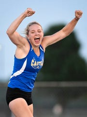 """Castle's Maddie Wilson reacts ofter clearing 11' 9"""""""