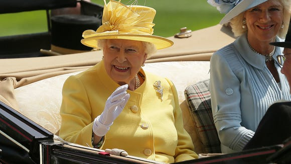 Queen Elizabeth II arrives at the parade ring with