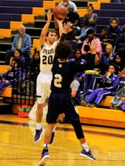 Wylie's Sam King shoot a 3-pointer over a Midland High defender during Tuesday's game. The Bulldogs won 88-51.