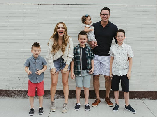 Author and entrepreneur Rachel Hollis poses with her four children and husband, Dave Hollis, CEO of The Hollis Co.
