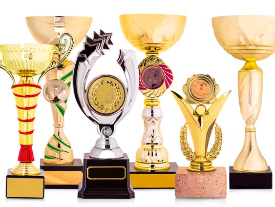 golden trophy isolated on white background.