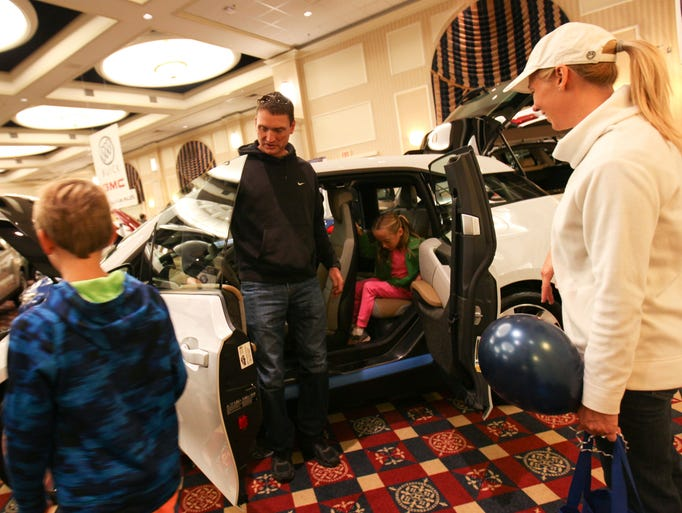 The Mervine family check out the BMW i3 during the