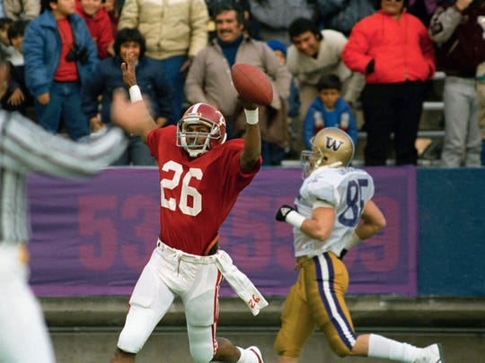 Alabama's Bobby Humphrey scores on a 64-yard run, one of his three touchdowns, as the Crimson Tide defeated Washington 28-6 in the 1986 Sun Bowl in El Paso, Texas.