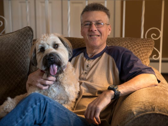 Greg Kava of Middletown is in need of a kidney. Family members have taken to advertising on the back of cars to find donors. Greg relaxes at home with his dog Sandy.Port Monmouth, NJWednesday, February 22, 2017.@dhoodhood