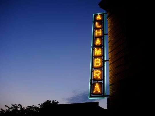 The illuminated marquee of the historic Alhambra Theater