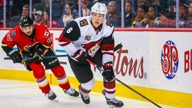 Oct 5, 2016; Calgary, Alberta, CAN; Coyotes defenseman Jakob Chychrun (6) controls the puck against the Flames during the third period during a preseason hockey game at Scotiabank Saddledome. Calgary Flames won 2-1.